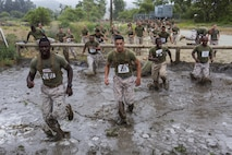 Approximately 2000 Marines and Sailors participated in the 2016 World Famous mud Run by Lake O'Neill here, June 3. The race was part of the Commanding General's Cup and covered about 6.5 miles. The race included a number of obstacles such as several mud pits, an ammo can run, a mud wall and many more. (U.S. Marine Corps photo by Cpl. Travis Jordan/Released)