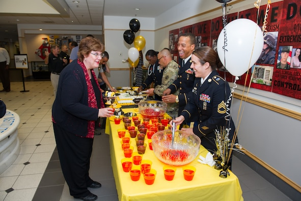 Members of Patrick Air Force Base and Cape Canaveral Air Force Station, Fla. celebrated the U.S. Army's 241st Birthday during a cake cutting ceremony at Defense Equal Opportunity Management Institute June 14, 2016. Medal of Honor recipient retired Sergeant 1st Class Melvin Morris, was the guest speaker for the event and shared his feelings about how honored he is to be a part of the military family and shared stories from his days on active duty. (U.S. Air Force photo/Benjamin Thacker/Released)
