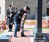 "Command Sgt. Maj. Joseph C. Cornelison, the 1st Infantry Division's senior noncommissioned officer, places a wreath in front of the Navarro County War Memorial in Corsicana, Texas, May 30.  Cornelison represented the 1st Inf. Div. during a ceremony honoring Sgt. Candelario Garcia Jr., a Vietnam-era Medal of Honor recipient, where the community unveiled a bronze statue of Garcia.  Garcia was a ""Big Red One"" Soldier assigned to the 1st Bn., 2nd Inf. Regt., also known as the ""Black Scarves,"" at the time of his heroism."
