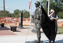 "Leslie Cotton, a U.S. Army veteran, unveils a bronze statue of Sgt. Candelario Garcia Jr., a Medal of Honor recipient and native of Corsicana, Texas, during a Memorial Day ceremony in front of the Navarro County Courthouse in Corsicana May 30.  Garcia, a Vietnam veteran, originally received the Distinguished Service Cross for his heroic actions near Lai Khe, Vietnam, in December 1968, but the award was upgraded to the nation's highest in 2014 as a result of the defense authorization act which reviewed medals for heroism that were denied due to racial and religious prejudice.  Garcia was a ""Big Red One"" Soldier assigned to the 1st Bn., 2nd Inf. Regt., also known as the ""Black Scarves,"" at the time of his heroism."
