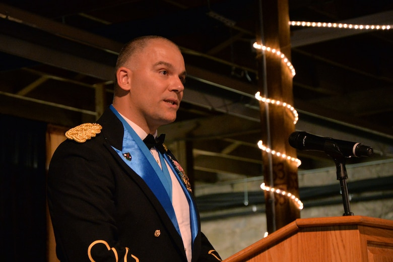 U.S. Army Lt. Col. Jason Hallock, 344th Military Intelligence Battalion Commander, speaks about the Army's 241st birthday during the 344th MI BN Army Ball at the Fort Concho Stables in San Angelo, Texas, June 10, 2016. Hallock talked about the importance of the Army's history and traditions. (U.S. Air Force photo by Airman 1st Class Randall Moose/Released)