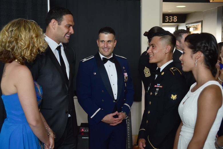 Mark Sanchez, quarterback on the Denver Broncos, greets military members during the 743rd Military Intelligence Battalion's 2016 Army Ball June 10, 2016, at Sports Authority Field at Mile High in Denver. The 743rd MIB held a ball in honor of the U.S. Army's 241st birthday. (U.S. Air Force photo by Airman 1st Class Luke W. Nowakowski/Released)