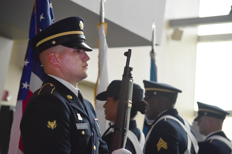 Spc. Christopher McGahey, 743rd Military Intelligence Battalion analyst, stands at attention during the presentation of the colors during the 743rd MIB 2016 Army Ball June 10, 2016, at Sports Authority Field at Mile High in Denver. The 743rd MIB held a ball in honor of the Army's 241st birthday. (U.S. Air Force photo by Airman 1st Class Luke W. Nowakowski/Released)