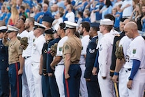 Service members honor the flag during the National Anthem May 30 at Kauffman Stadium in Kansas City, Missouri. They participated in various pre-game festivities honoring military past, present and future.