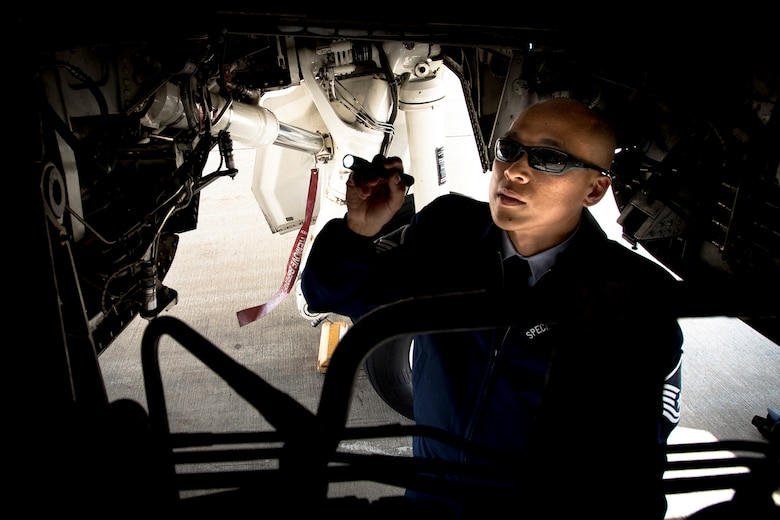 Master Sgt. Kristofer Reyes, a 99th Airlift Squadron flight engineer, inspects a C-37A at Joint Base Andrews, Md., June 7, 2016. Reyes is responsible for monitoring and maintaining the mechanical and electrical systems on the C-37A, which is a highly modified Gulfstream G5, and is used, along with the VC-25, C-20B, C-37B, C-32A and C-40B for executive airlift of the U.S. president, vice president, cabinet members, combatant commanders, and other senior military and elected leaders. (U.S. Air Force photo/Senior Master Sgt. Kevin Wallace)