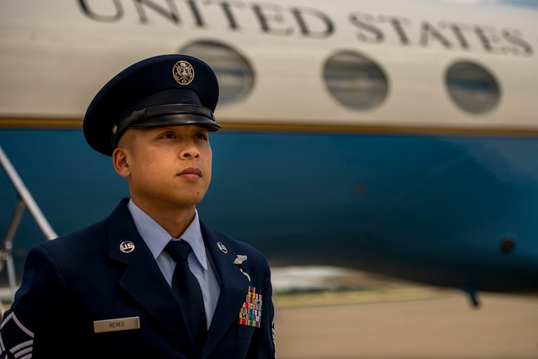 Master Sgt. Kristofer Reyes, a 99th Airlift Squadron flight engineer, stands at parade rest in front of a C-37A and awaits the arrival of a U.S. senior elected leader at Joint Base Andrews, Md., June 7, 2016. In addition to monitoring and maintaining the mechanical and electrical systems on the C-37A, a highly modified Gulfstream G5 aircraft, flight engineers are also responsible for greeting their customers, which are typically the U.S. vice president, cabinet members, combatant commanders, and other senior military and elected leaders. (U.S. Air Force photo/Senior Master Sgt. Kevin Wallace)
