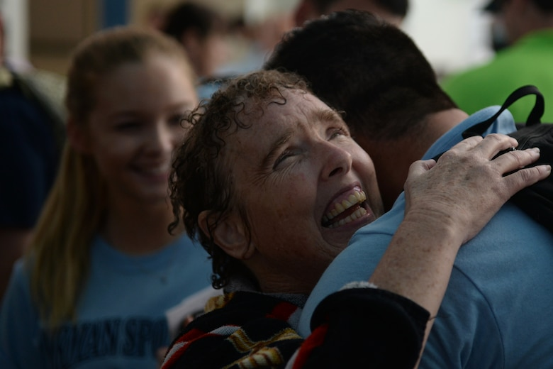 Paula Carpenter, District 5 Special Olympics Mississippi athlete, hugs Senior Airman Hashim Mefleh, 336th Training Squadron student, after finishing the 50 meter backstroke at the Biloxi Natatorium May 21, 2016, Biloxi, Miss. Mefleh, one of Carpenter's Airman sponsors, cheered her on in her three aquatics events and got to know her for the three days of Special Olympics. (U.S. Air Force photo by Airman 1st Class Travis Beihl)