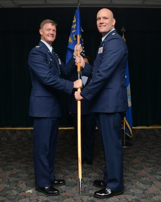 Maj. Brian Erickson, right, 47th Comptroller Squadron commander, poses for a photo with Col. Thomas Shank, 47th Flying Training Wing commander, during a change of command at Laughlin Air Force Base, Texas, May 25, 2016. Erickson came to Laughlin from his previous position as an executive officer at headquarters Air Education and Training Command. (U.S. Air Force photo/Airman 1st Class Brandon May)