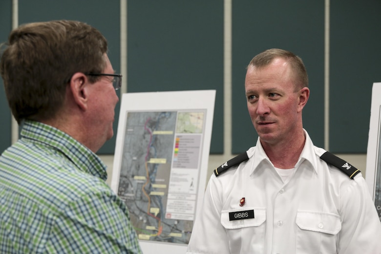 Col. Kirk Gibbs, commander of the U.S. Army Corps of Engineers Los Angeles District, speaks with Mayor Robin Boyd at the District's public meeting in Winslow, Ariz., June 9. Two meetings were held for the Draft Integrated Feasibility Report and Environmental Impact Statement on the Little Colorado River in Navajo County, Arizona. In 2008, the Federal Emergency Management Agency de-accredited the Winslow Levee.