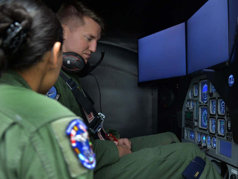 Senior Airman Alejandra Ortiz, 82nd Aerospace Medical Squadron technician prepares a student pilot before he trains using the GYRO Integrated Physiological Trainer II simulator during the first phase of ENJJPT training. The simulator allows student pilots to feel, recognize and correct the effects of spacial disorientation before they ever actually fly an airframe. (U.S. Air Force photo/Liz Colunga)