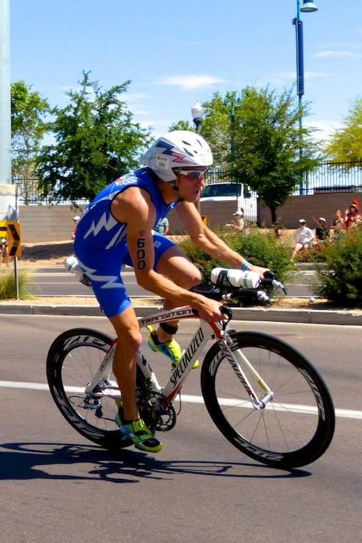1st Lt. John Bierman, 2nd Space Warning Squadron Delta Crew deputy flight commander, rides a bike in a 2014 triathlon in Tempe, Arizona. Bierman competed for four years on the United States Air Force Academy triathlon team and will compete for the third time on the U.S. Air Force triathlon team June 15-19, 2016, in Ventura County, Calif. (Courtesy photo by Vivien Cook)