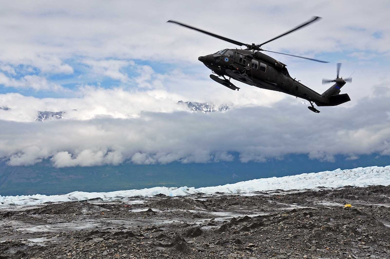 An Alaska Army National Guard UH-60 Black Hawk helicopter lands on top of Colony Glacier near Anchorage, Alaska to pick up personnel as part of Operation Colony Glacier. The operation is a mission to recover human remains and remove debris from a 1952 crash of a U.S. Air Force C-124 Globemaster II on the glacier with 52 servicemembers on board. The recovery effort has taken place every summer since 2012 by personnel from Alaskan Command, the Alaska National Guard, Air Force Mortuary Affairs Operations, U.S. Army Alaska, 673d Air Base Wing, 3d Wing and Detachment 1, 66 Training Squadron. (U.S. Air Force photo/Capt. Anastasia Wasem)