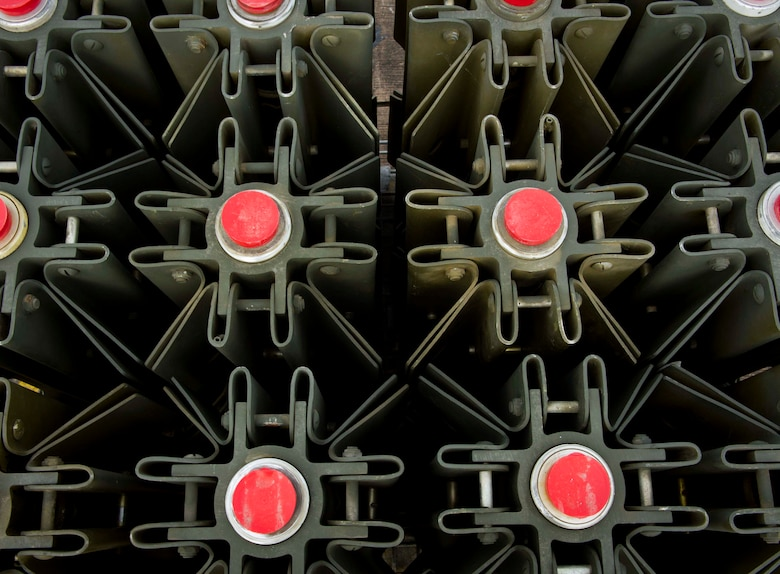 MK-15 tail fins rest in a rack at Royal Air Force Fairford, United Kingdom, June 8, 2016. Members from 5th Expeditionary Munitions Squadron helped U.S. Navy minemen build 12 inert mines for a BALTOPS 16 exercise testing the B-52H Stratofortress' ability to precisely drop munitions into a target zone. (U.S. Air Force photo/Senior Airman Sahara L. Fales)