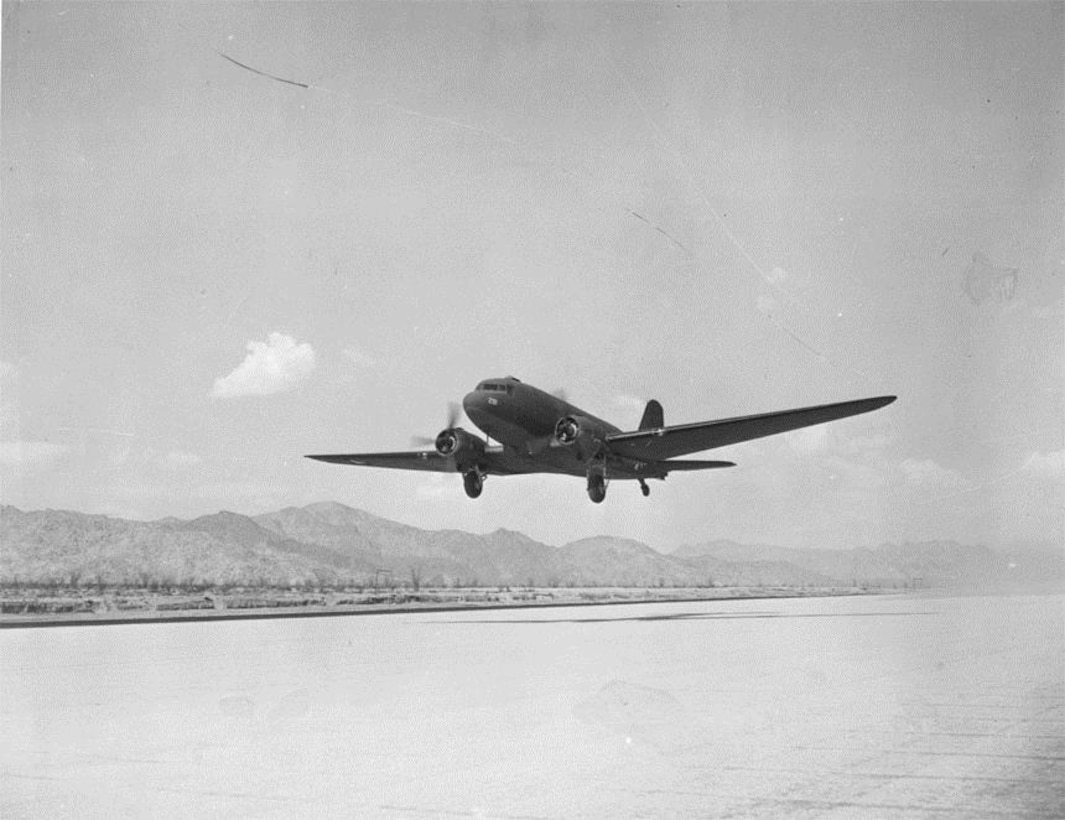 A Douglas C-47 Skytrain transport, similar to the kind used by Portland's 16th Transport Squadron in 1941-1942, is seen in this picture about to land at the new airfield at Camp Young, Indio, California, circa 1942.  (U.S. Air Force Photo)