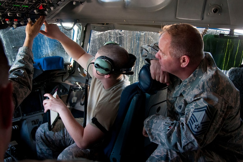 Staff Sgt. Derek Meacham (left), a member of the communication and navigation section at the 167th Airlift Wing in Martinsburg, W.Va., does a power on/ interphone operations check while Senior Master Sgt. Curtis Surratt, also a member of the communication and navigation section, watches, June 10, 2016. The maintenance group took advantage of the super drill my having hands on refresher training on the C-17 Globemaster during super drill. (U.S. Air National Guard photo by Staff Sgt. Jodie Witmer)