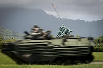An Amphibious Assault Vehicle with Combat Assault Company, 3rd Marine Regiment, drives by the Pacific War Memorial aboard Marine Corps Base Hawaii, June 13, 2016. The CAC Marines came ashore after practicing towing drills in Kaneohe Bay to gain a good understanding of what to do in the event an AAV breaks down or gets stuck.