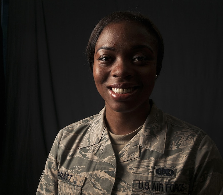 Senior Airman Ja'Mesha Pratt, 18th Operations Support Squadron airfield systems technician, poses for a photo June 15, 2016, at Kadena Air Base, Japan. Pratt heroically saved the lives of two local Okinawans after witnessing them involved in a terrible accident. She pulled them from their overturned vehicle and applied Self-Air Buddy care until first-responders arrived. (U.S. Air Force photo by Naoto Anazawa)