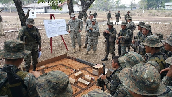 Staff Sgt. Bitzer and Spc. Hernandez cover terrain models during a class on troop-leading procedures with Reconaissance Soldiers from the 1st Infantry Brigade on May 12, 2016.