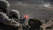 Reserve Marines with 1st Battalion, 24th Marines, 25th Marine Regiment, 4th Marine Division, Marine Forces Reserve, provide suppressive machine gun fire for ground units at range 410A during Integrated Training Exercise 4-16, at Marine Corps Air Ground Combat Center Twentynine Palms, California, June 14, 2016. ITX 4-16 allows Reserve Marines to train in realistic environments to increase their proficiency and readiness.