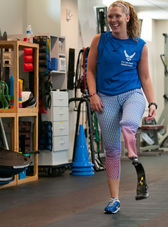 Heather Carter, an above-knee amputee, walks with her prosthetic running blade on a track inside the Military Advanced Training Center at Walter Reed National Military Medical Center in Bethesda, Md., April 13, 2016. Carter, a medically retired senior airman, and other amputees receive physical and occupational therapy at the center as they work toward their goals. One of Carter's goals is to return to competitive softball. (U.S. Air Force photo/Sean Kimmons)