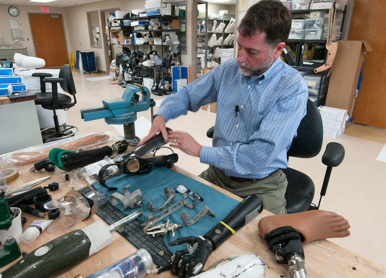 David Beachler, a prosthetist, works at his desk inside the prosthetics fabrication room at Walter Reed National Military Medical Center in Bethesda, Md., April 13, 2016. Amputees are consulted before prosthetists design their customized lightweight prosthetics, which weigh less than the actual limb lost. Many of the devices are made or modified in-house. (U.S. Air Force photo/Sean Kimmons)