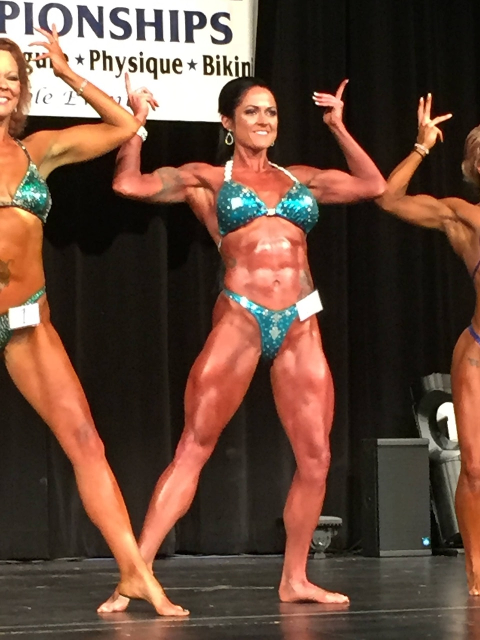 Marine Corps Staff Sgt. Annemarie E. Baker strikes a pose in the women's physique competition during the 2016 National Physique Committee Gran Prix Natural competition in Rockford, Ill., May 14, 2016. Women like Baker have proven bodybuilding competitions no longer belong exclusively to men, as more women -- and especially, mothers -- have started competing. Marine Corps photo by Staff Sgt. Robert L. Fisher III
