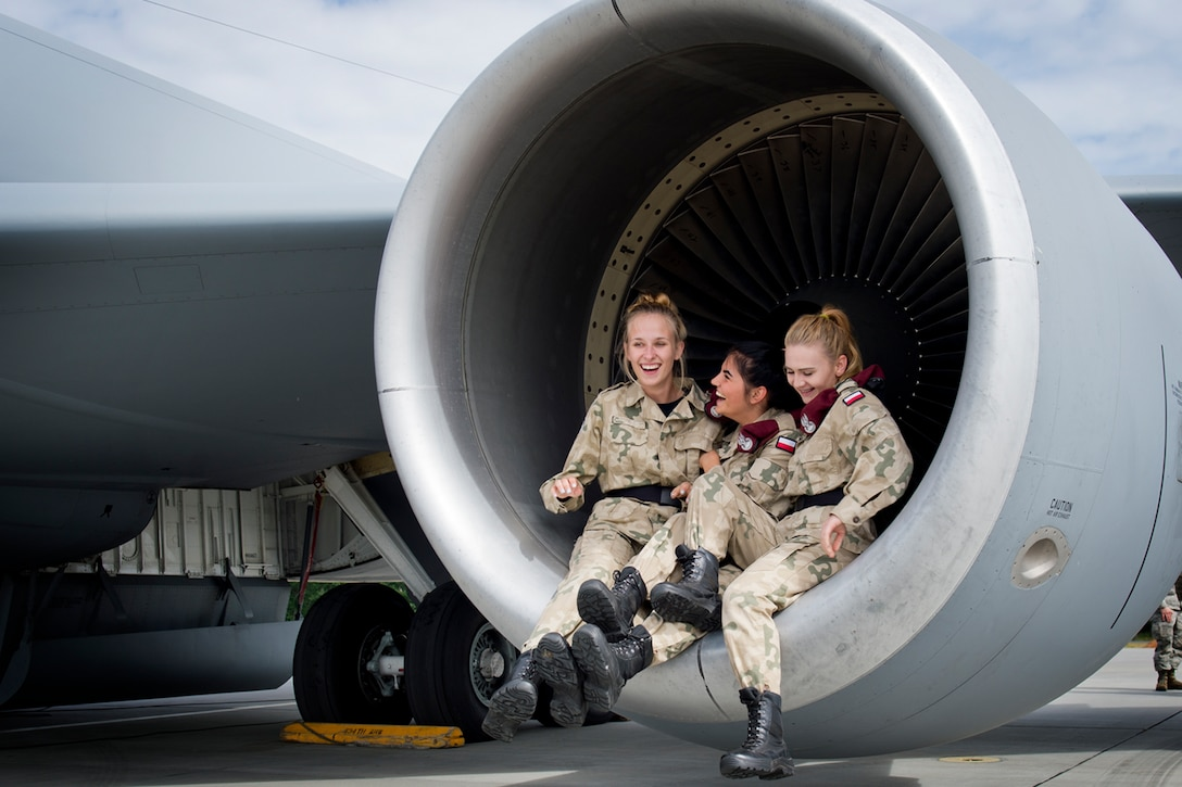 High school students from a military class at Adam Mickiewicz High School Complex, Kleczew, Poland, pose for a picture after learning about the KC-135 Stratotanker at Powidz Air Base, Poland, where the 434th and 100th Air Refueling Wings are based while taking part in Baltic Operations 2016, June 9, 2016. This event allowed a younger generation from Poland to interact with U.S. Airmen and see firsthand how the U.S. Air Force operates. (U.S. Air Force photo/Senior Airman Erin Babis)