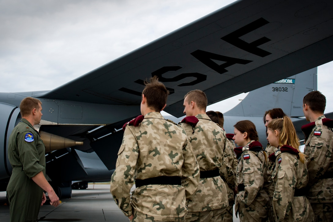 Major Micah Jones, 434th Air Refueling Wing KC-135 Stratotanker pilot, teaches high school students from a military class at Adam Mickiewicz High School Complex, Kleczew, Poland, about the KC-135 Stratotanker at Powidz Air Base, Poland, where the 434th and 100th ARWs are based while taking part in Baltic Operations 2016, June 9, 2016. This event allowed a younger generation from Poland to interact with U.S. Airmen and see firsthand how the U.S. Air Force operates. (U.S. Air Force photo/Senior Airman Erin Babis)