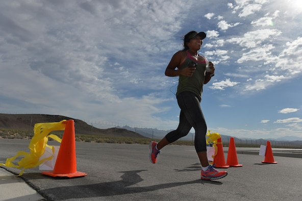 An Airman assigned to the 432nd Wing/ 432nd Air Expeditionary Wing at Creech Air Force Base, Nevada, runs during a 5k and 10 k race June 10, 2016.To help promote physical readiness, obstacle courses, races and unit workout sessions are organized on a regular basis at Creech. (U.S. Air Force photo by Airman 1st Class Kristan Campbell/Released).