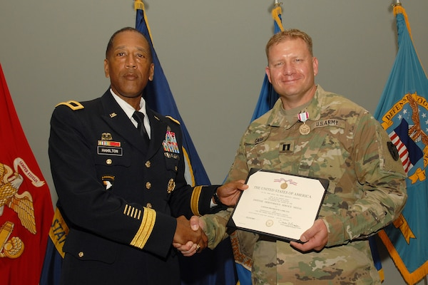 Army Captain Capt. Franklin Carr receives a Defense Meritorious Service Award from Army Brig. Gen. Charles Hamilton, Defense Logistics Agency Troop Support commander, during a quarterly awards ceremony June 14.