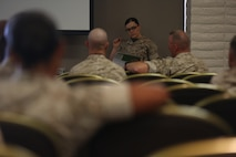 """MARINE CORPS BASE CAMP PENDLETON, Calif. – Maj. Misty Posey the Plans Officer with the Manpower Integration Office, Headquarters Marine Corps, educates an audience about the integration of female Marines into previously closed combat arms occupations and units at the Unit Event Center June 8, 2016. The goal of integration education training is to ensure commanders and staffs are sufficiently educated and prepared to receive Marines of either gender by October 31, 2016 (active) and January 31, 2017 (reserve). """"I hope we get to the point where people look at female Marines as Marines first and as women second,"""" Posey said. (U.S. Marine Corps photo by Lance Cpl. Shellie Hall/ Released)"""