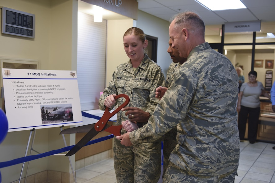 U.S. Air Force Capt. Aubrie Wnek, 17th Medical Support Squadron pharmacy element chief, Lt. Col. Bernard VanPelt, 17th MDSS Commander, and Col. Michael Downs, 17th Training Wing Commander, cut the ribbon during the ceremony for the new medsafe drop box at the Ross Medical Clinic Pharmacy on Goodfellow Air Force Base, Texas, June 13, 2016. Goodfellow members can now turn in unused prescription medication year round. (U.S. Air Force photo by Airman 1st Class Chase Sousa/Released)