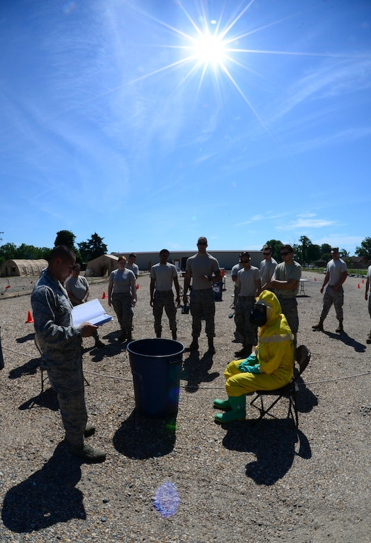 Airman 1st Class Alexander Trippett, 2nd Civil Engineer Squadron explosive ordnance disposal apprentice, briefs the emergency management support team on a decontamination exercise at Barksdale Air Force Base, La., June 6, 2016. The EMST is made up of Airmen from various offices throughout 2nd CES and is augmented to aid Barksdale's emergency management team during an emergency situation. (U.S. Air Force photo/Senior Airman Luke Hill)