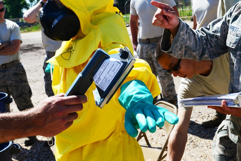 Airmen check for radiation during a decontamination training exercise for the emergency management support team at Barksdale Air Force Base, La., June 6, 2016. Keeping the EMST up to speed enables emergency management to respond quicker and more efficiently. (U.S. Air Force photo/Senior Airman Luke Hill)