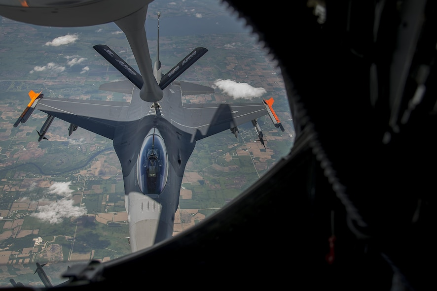 An F-16 jet from the Fighter Wing of the Wisconsin Air National Guard participates in an air refueling mission June 3, 2016. The mission was a training sortie focusing on maintain aircrew readiness in conjunction with the 906th Air Refueling Squadron and the 126th Air Refueling Wing. (U.S. Air Force Photo by Airman Daniel Garcia)