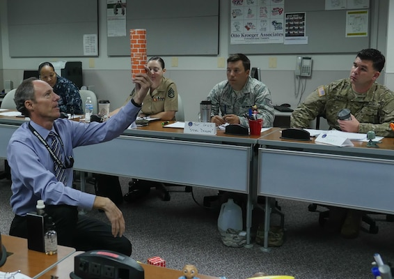 Wes Ellenburg, Instructor Training Course instructor, uses card board building blocks to teach the Instruction Systems Design process at the Defense Information School, Fort George G. Meade, Md., Sept. 11, 2015. The course focuses on the basics of developing lesson plans, creating an active learning environment and delivering content in an engaging way.