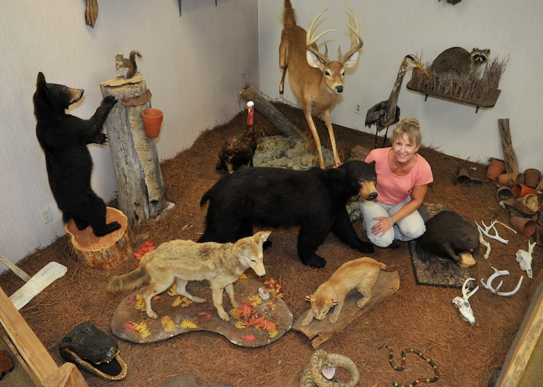 Beckie Johnson, assigned to the 325th Civil Engineer Squadron Natural Resources, poses for a photo with different species of wildlif found at Tyndall Air Force Base, Fla., June 10, 2016, at the Natural Resources office.  Natural Resources is comprised of three sections and six team members that oversee natural resources at Tyndall AFB. (U.S. Air Force photo by Senior Airman Sergio A. Gamboa/Released)