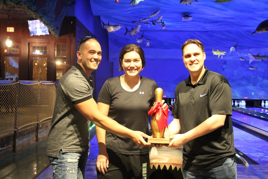 The Western Air Defense Sector wins the second annual USO Northwest All American Oh-Pin bowling tournament on May 24. The Golden Bowling Pin trophy was presented to Michael Doing (from right to left), Elisa Layton, David Bauld and Chris Worden (not pictured). The tournament raised over $1,000 for the USO Helping Hands program. (Courtesy photo by Kevin Iriarte, USO Northwest)