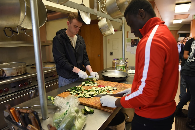 Senior Airmen Cameron Brisson, left, and Daniel Kuma, 30th Medical Operations Squadron bioenvironmental technicians, prepare vegetables for a weekly meal service at the La Purisima Community Kitchen, June 10, 2016. For about 10 years now, volunteer teams from Vandenberg have been working in the kitchen and serving line of the La Purisima Community Kitchen, helping provide weekly meals to those in need. (U.S. Air Force photo by Michael Peterson/Released)