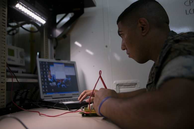 Lance Cpl. Joshua Lowry diagnoses a faulty circuit card on Camp Courtney June 2, 2016. He is pin-pointing where the damaged is located by sending a current through the circuit and watching for a response. Lowry, a Bergen County, New Jersey, native, is a miniature/ micro-miniature technician with Maintenance Platoon, Communications Company, Headquarters Battalion, 3rd Marine Division, III Marine Expeditionary Force