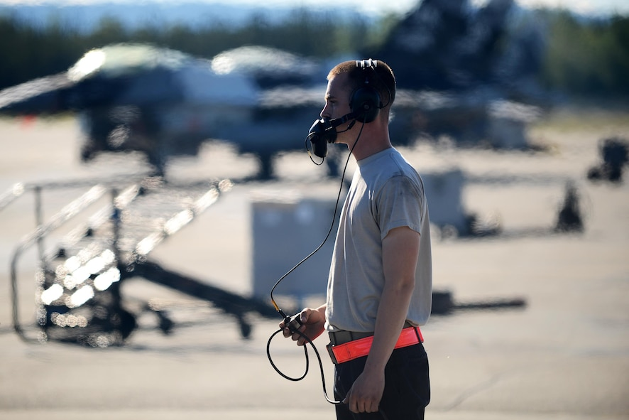 U.S. Air Force Airman 1st Class Michael Brinkmeyer, an F-16 Fighting Falcon assistant dedicated crew chief with the18th Aircraft Maintenance Unit, completes final checks with the pilot during RED FLAG-Alaska 16-2, on Eielson Air Force Base, Alaska, June 15, 2016. (U.S. Air Force photo by Tech. Sgt. Steven R. Doty)
