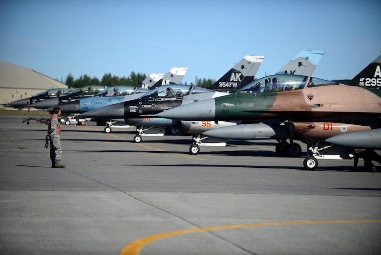 U.S. Air Force Staff Sgt. William Robb, a resource advisor and F-16 Fighting Falcon dedicated crew chief with the18th Aircraft Maintenance Unit, supervises arming procedures during RED FLAG-Alaska 16-2, on Eielson Air Force Base, Alaska, June 15, 2016. (U.S. Air Force photo by Tech. Sgt. Steven R. Doty)