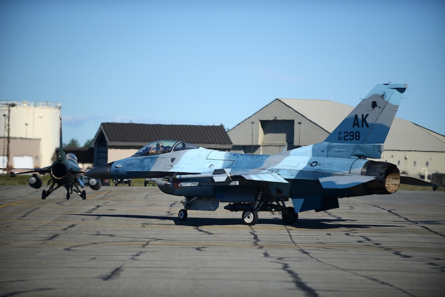 An F-16 Fighting Falcon assigned to the 18th Aggressor Squadron, departs for take-off during RED FLAG-Alaska 16-2, on Eielson Air Force Base, Alaska, June 15, 2016. (U.S. Air Force photo by Tech. Sgt. Steven R. Doty)