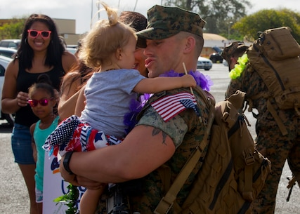 A U.S. Marine assigned to 1st Battalion, 3d Marine Regiment, 3d Marine Division hugs his daughter at Marine Corps Base Hawaii, Kaneohe Bay, June 12, 2016. The battalion completed a successful six month Unit Deployment Program as forward deployed forces of 3d Marine Division.   (U.S. Marine Corps photo by Cpl. Ricky S. Gomez/Released)