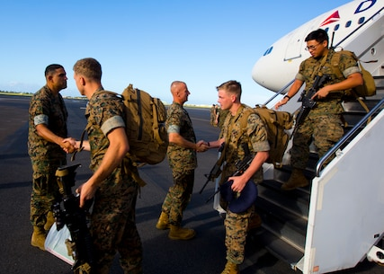 Sergeant Major Alfonso Via (left) and Colonel Carl Cooper (middle)  greet Marines assigned to 1st Battalion, 3d Marine Regiment returning from Okinawa, Japan.  The 3d Marine Regiment sergeant major and commanding officer traveled to Joint Base Pearl Harbor Hickam to welcome the Marines June 13, 2016 after a successful Unit Deployment Program as forward deployed forces of 3d Marine Division. (U.S. Marine Corps photo by Cpl. Ricky S. Gomez/Released)