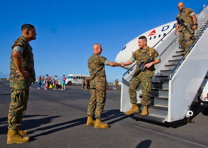 Sergeant Major Alfonso Via (left) and Colonel Carl Cooper (middle)  greet Sergeant Major Matthew Fouss  and Lieutenant Colonel Quintin Jones returning from Okinawa, Japan.  The 3d Marine Regiment sergeant major and commanding officer traveled to Joint Base Pearl Harbor Hickam to welcome the commanding officer and sergeant major of 1st Battalion, 3d Marines June 13, 2016 after a successful Unit Deployment Program as forward deplohyed forces of 3d Marine Division. (U.S. Marine Corps photo by Cpl. Ricky S. Gomez/Released)