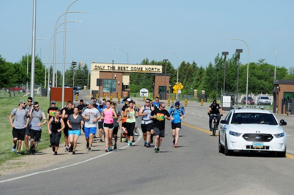 team minot sf members pass the torch for special olympics
