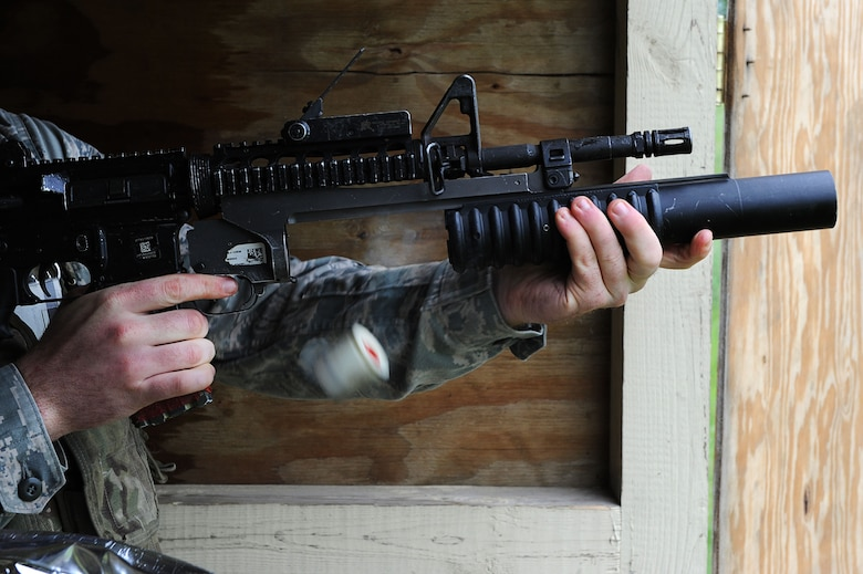A defender from Team Minot releases an M-203 grenade launcher cartridge after firing a round at Minot Air Force Base, N.D., June 15, 2016. Prior to firing, the defenders learned how to break down the M-203 and clean it. To carry the weapon, defenders must qualify annually. (U.S. Air Force photo/Senior Airman Kristoffer Kaubisch)