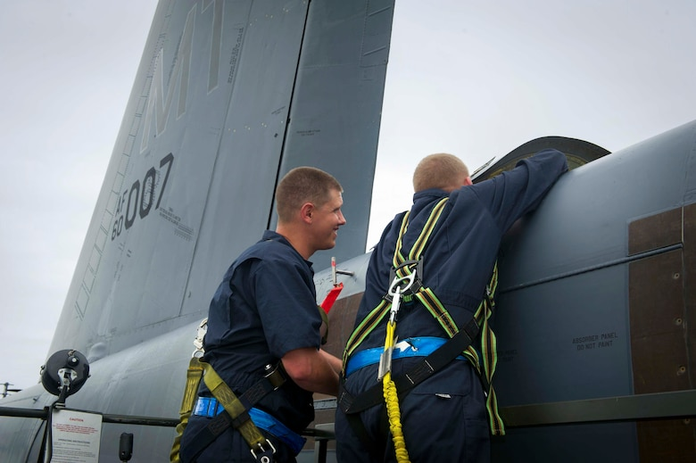 (From right) U.S. Air Force Staff Sgts. Matthew Hardwig and Justin Yochum, 5th Expeditionary Maintenance Squadron aerospace repair and reclamation craftsman and journeyman, place a drag chute into a B-52H Stratofortress at Royal Air Force Fairford, United Kingdom, June 13, 2016, following a Saber Strike 16 mission. When released, the pilot chute pulls free a three-pinned ripcord which deploys the main chute from the deployment bag. Both the deployment bag and canister are removed for repacking of the drag and pilot chute. (U.S. Air Force/Senior Airman Sahara L. Fales)