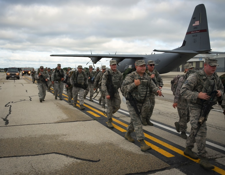 The Security Forces Squadron Airmen with the 128th Air Refueling Wing, Wisconsin Air National Guard, participate in a ruck march June 5, 2016, at General Mitchel International Airport. The march was in honor of Staff Sgt. Louis M. Bonacasa and Technical Sgt. Joseph G. Lemm who, along with four other Airmen, lost their lives in Afghanistan to a suicide bomber attack. (U.S. Air National Guard photo by Senior Airmen Morgan R. Lipinski/Released)